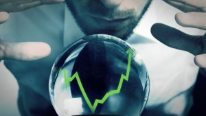 A man is using a crystal ball to try and read future stock markets