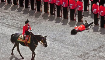 A guard of honor passes out as Queen Elizabeth II rides past during the trooping the color parade, 1970