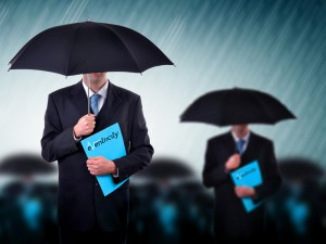 Man under umbrella in downpour holding an eventricity folder